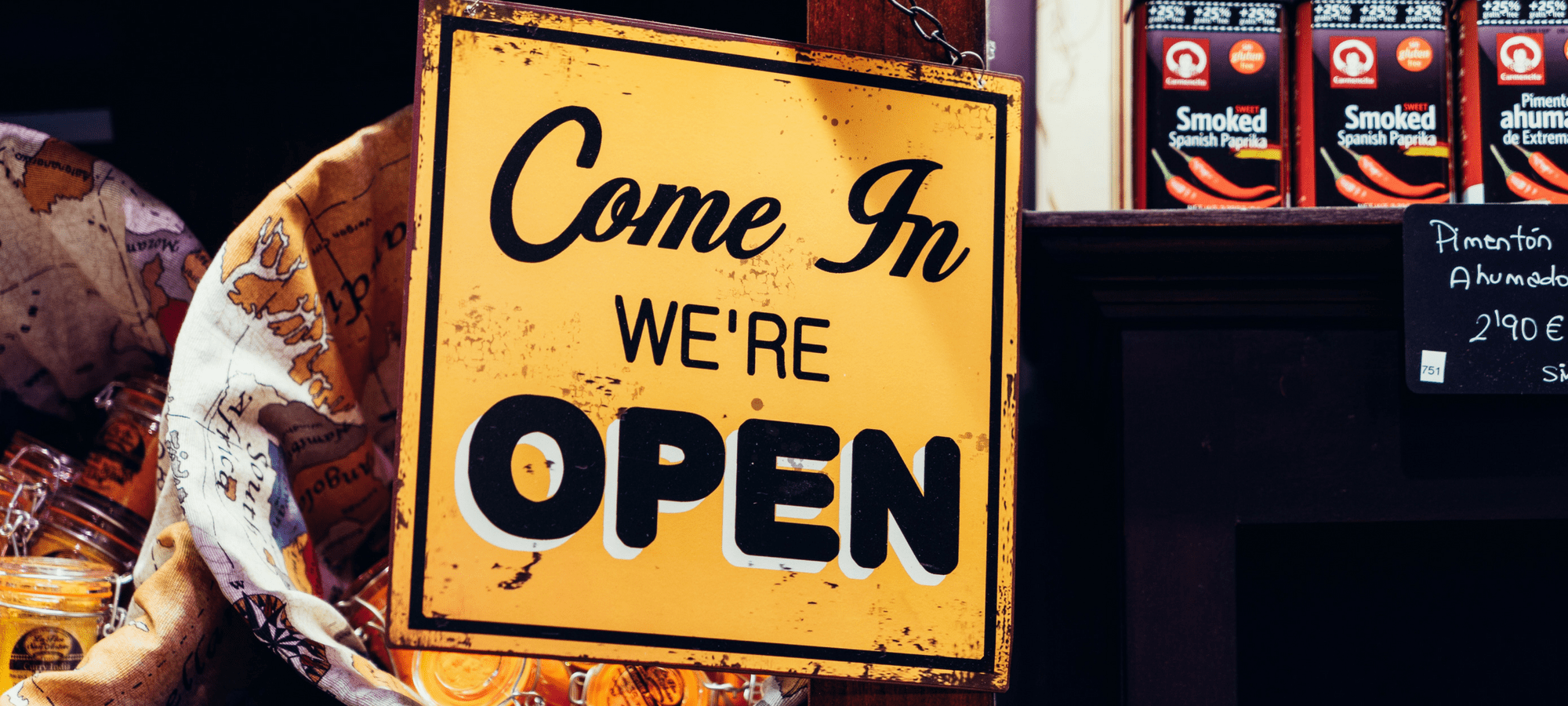 We're open, yellow shop sign