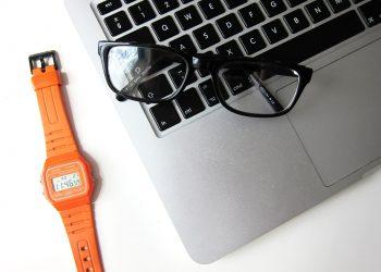 Eye glasses resting on a laptop.