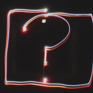 Neon lights in the shape of a question mark.