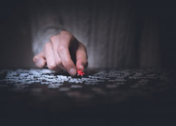 A person holding a puzzle piece.